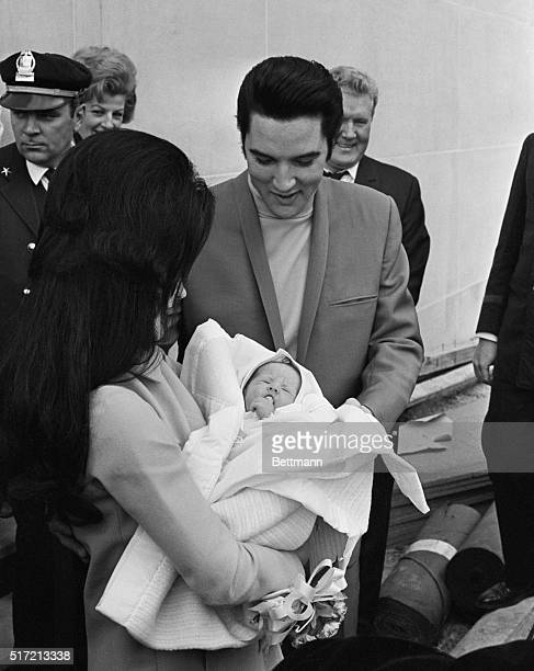 2/7/1968Memphis Tennessee Singer Elvis Presley and his wife Priscilla with their new daughter leave Baptist Hospital in Memphis