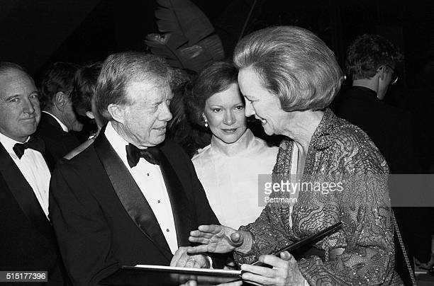 Former President and Mrs Jimmy Carter chat with Katharine Graham Chairman of the Washington Post Company during gala celebration in honor of...