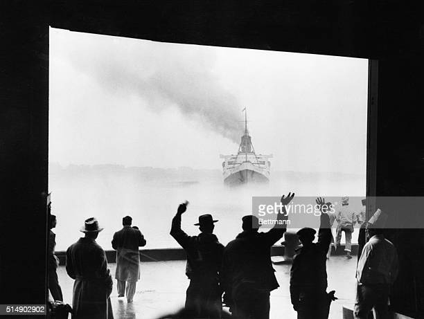 New York: This unusual photo captures the unreal feeling that permeated the North River pier today when the liner Queen Mary set sail for Europe....