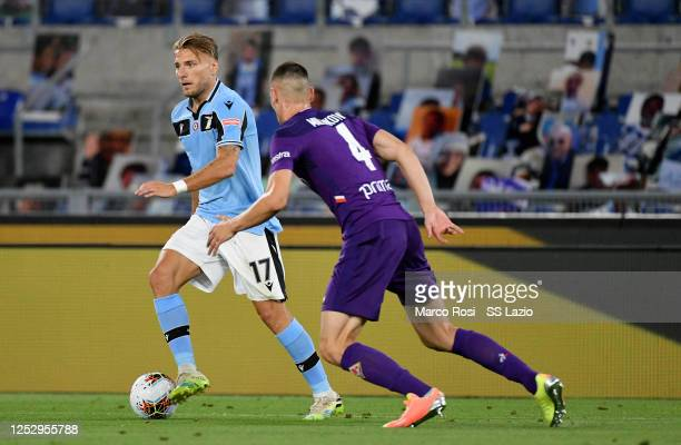 ROME ITALY JUNE 27Nikola Milenkovic of ACF Fiorentina compete for the ball withCiro Immobile of SS Lazio during the Serie A match between SS Lazio...