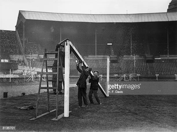 Ground staff make preparations for the cup final match between Manchester City and Everton