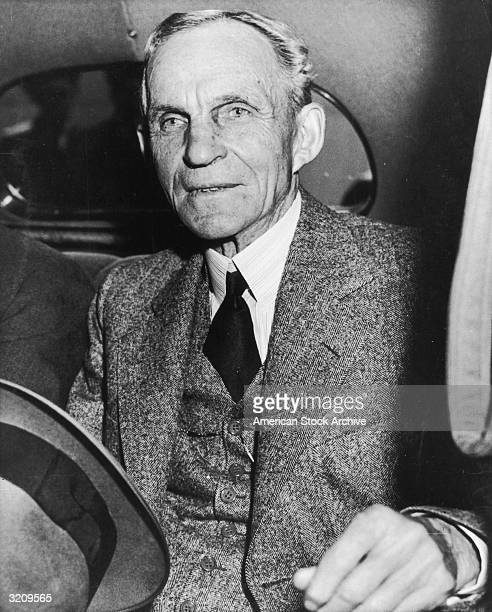 American inventor and industrialist Henry Ford sitting in the back seat of an automobile after a lunch meeting with President Franklin D Roosevelt