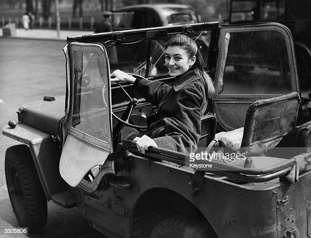French film actress Anouk Aimee celebrating her birthday with a jeep-drive through London.