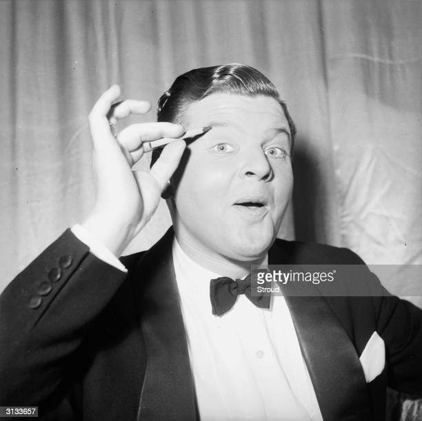 English comedian Benny Hill originally Alfred Hawthorne Hill applying makeup to his eyes