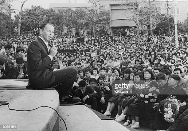 American actor and singer Frank Sinatra singing to crowds during a charity concert in Hibiya Park Tokyo