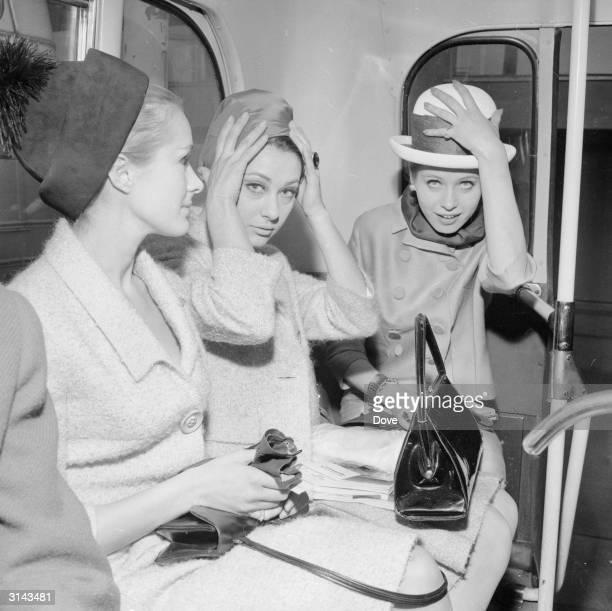 Air hostesses Aldine Honey Ann Lloyd James and Ann Renvoize prepare to board a BEA passenger plane for Paris
