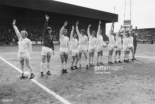 League champions Leeds United line up at Loftus Road Team skipper Billy Bremner and his squad salute the crowd before the kick off against Queens...