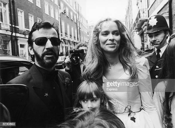 English musician and former Beatle Ringo Starr stands next to his smiling wife, American actress Barbara Bach, with Starr's daughter Lee Starkey...