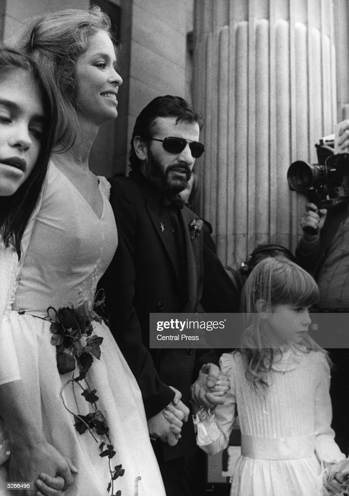 Former Beatle Ringo Starr (C) with his new bride, American actress Barbara Bach (2nd L), her daughter Francesca Gregorini (L), and his daughter Lee Starkey (R) during the Starr/Bach wedding ceremony at Marylebone Register Office, London.