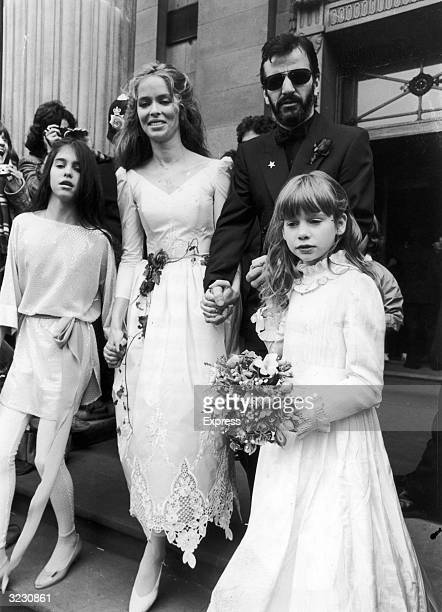 Left to right Francesca Gregorini American actress Barbara Bach English musician Ringo Starr and Lee Starkey walk together hand in hand on Starr and...
