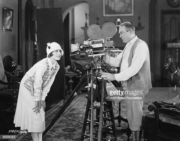 Canadian actress Norma Shearer shows her best side to the camera during the filming of 'A Slave of Fashion' directed by Hobart Henley