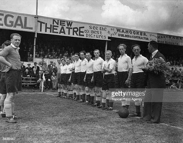 Dutch football team made up from 80 athletes led by Burgomaster H Witts on a visit to Boston Lincolnshire They line up before the start of a match...