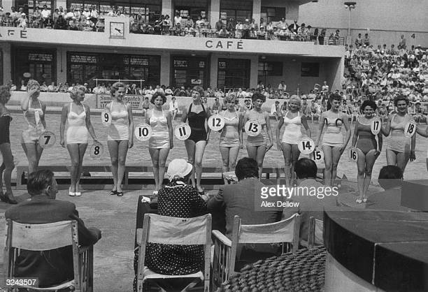Contestants line up before the judges at a beauty competition at Butlin's holiday camp at Blackpool in Lancashire Original Publication Picture Post...