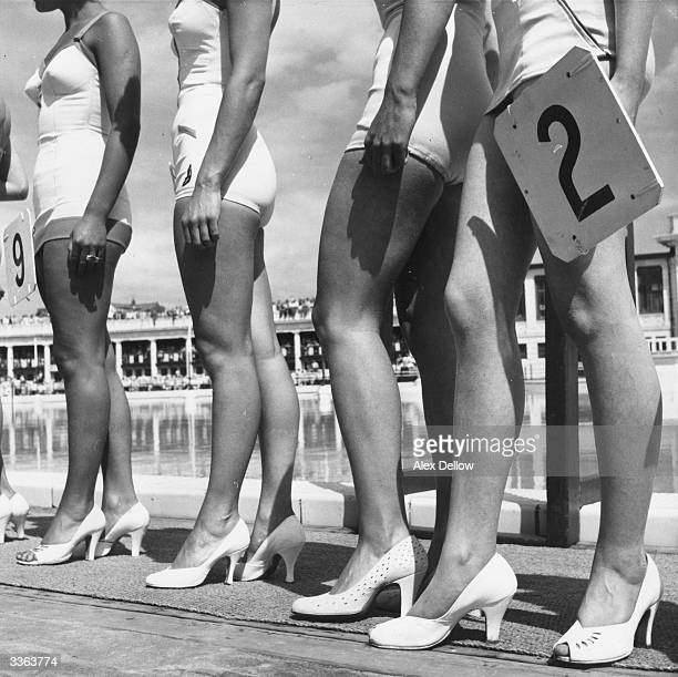 The winners of the Blackpool Bathing Beauties Contest line up by the swimming pool Original Publication Picture Post 7961 The Beauty Business pub 1955