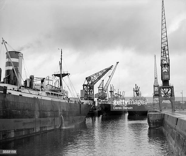 Three ships in the flooded King George V dry dock at Southampton being loaded with war material for the Mediterranean The ship are the Rivercrest the...