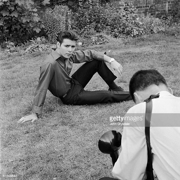 27th August 1963 British pop star Cliff Richard poses for a photographer in the garden of his home in St Anne's Blackpool