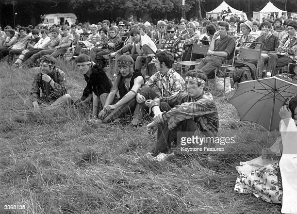 Festival goers and hippies in the grounds of Woburn Abbey the seat of the Duke of Bedford in Bedfordshire