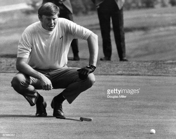 British born Peter Oosterhuis lines up a putt at fourth hole at Moor Park course Rickmansworth.