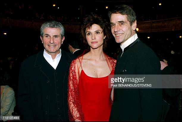 27th Cesar movie awards ceremony in Paris in Paris France on March 02 2002 Claude Lelouch with his wife Alessandra Martines and Jeremy Irons