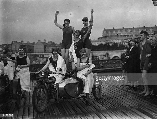 Members of the Plymouth Ladies and 7 o'clock Regulars Swimming Club arrive on motorbikes for their swim on Christmas morning