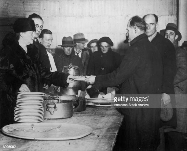Dolly Gann sister of US vice president Charles Curtis helps serve meals to the hungry at a Salvation Army soup kitchen during the Great Depression A...