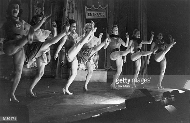 High kicking on stage chorus girls at the Collins Music Hall in Islington London Original Publication Picture Post 993 The London Music Hall pub 1941