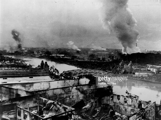 Everywhere fires burn in Manila following the bombing by the Japanese forces and the fires set when they left the city as American troops recaptured...
