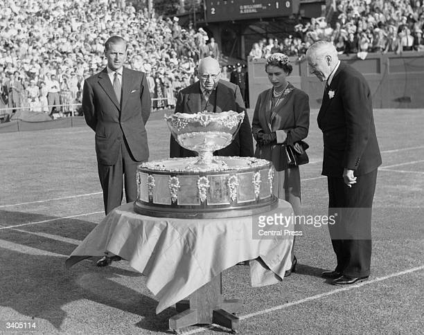 From left to right the Duke of Edinburgh H A Pitt president of the Victorian Lawn Tennis Association Queen Elizabeth II and Sir Norman Brookes...