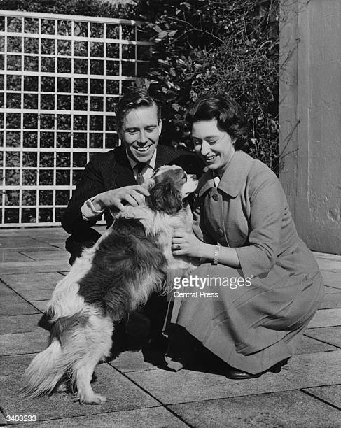 Princess Margaret and her fiance Antony ArmstrongJones stroking their pet King Charles Spaniel at the Royal Lodge Windsor