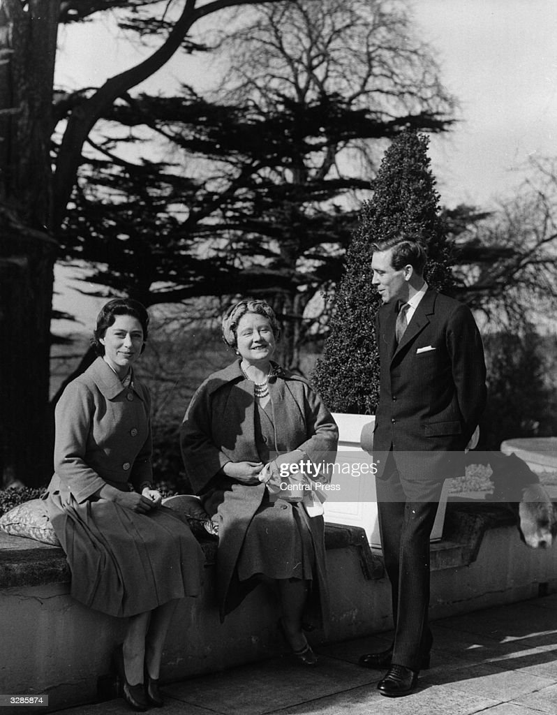Princess Margaret Rose (1930 - 2002) and Antony Armstrong-Jones, subsequently the Earl and Countess Snowdon, with Queen Elizabeth The Queen Mother at The Royal Lodge, Windsor after announcing their marriage engagement.
