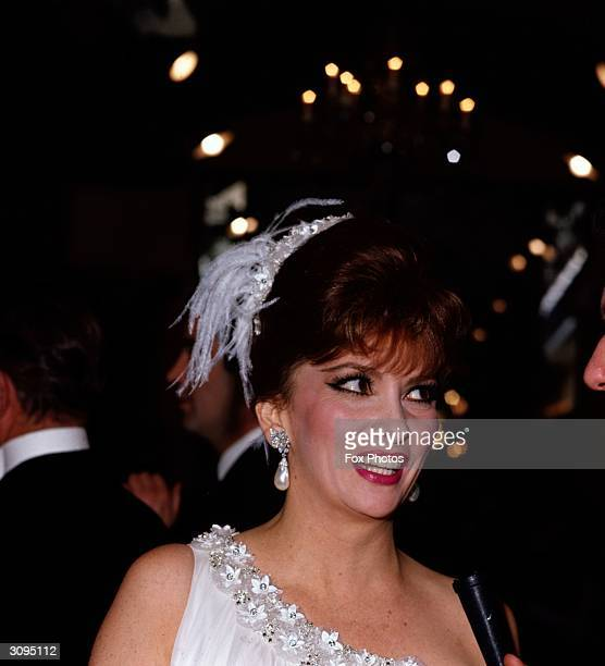 Italian actress Gina Lollobrigida attending the royal film performance of 'The Taming of the Shrew' London