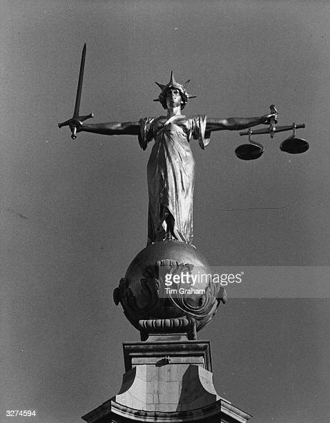 The Statue of Justice on top of the Central Criminal Court popularly known as the Old Bailey in the City of London The bronze figure of Justice is...