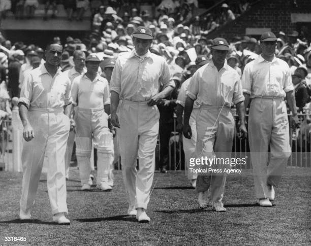 England cricket captain Douglas Jardine leads the MCC team onto the field for the second test match against Australia in Melbourne.