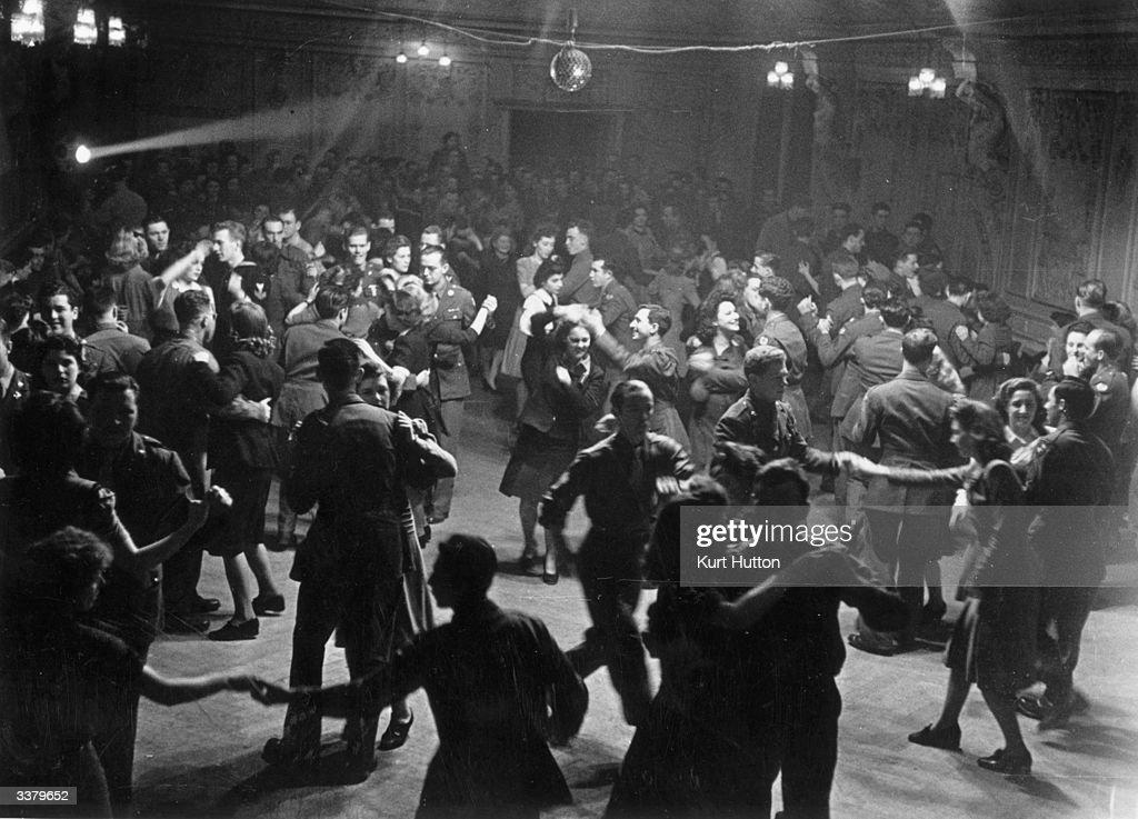 Dancing at Rainbow Corner a London club for American servicemen. Original Publication: Picture Post - 1887 - Inside Rainbow Corner - pub. 1945