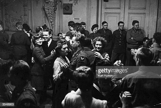 US soldiers dancing at Rainbow Corner the Red Cross club for American troops in London during the Second World War Original Publication Picture Post...