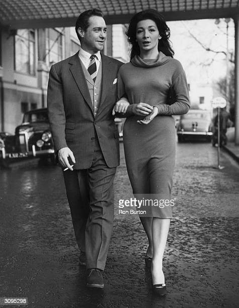 French actress Juliette Greco with her costar Richard Todd in London for the premiere of their new film 'The Naked Earth'