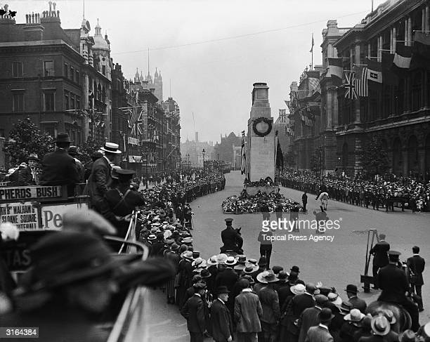 Crowds lining the streets during a war memorial ceremony at the Cenotaph in London