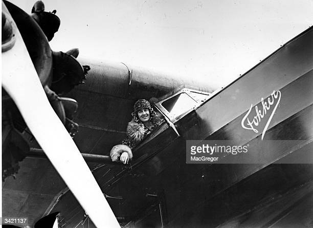 Lady Heath the first woman passenger line pilot in the cockpit of the Fokker Air Liner owned by Royal Dutch Air Lines after a flight from Amsterdam...