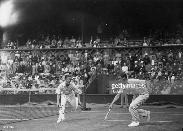 Pat Hughes and Raymond Tuckey of Great Britain playing against J H Crawford and Adrian Quist of Australia at the Davis Cup Tennis Championships at...