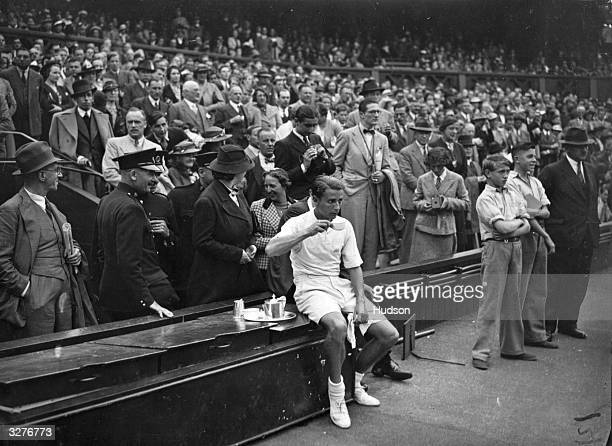 British player Henry Wilfred 'Bunny' Austin having a cup of tea after being defeated by an American Donald Budge in the closing stages of the Davis...