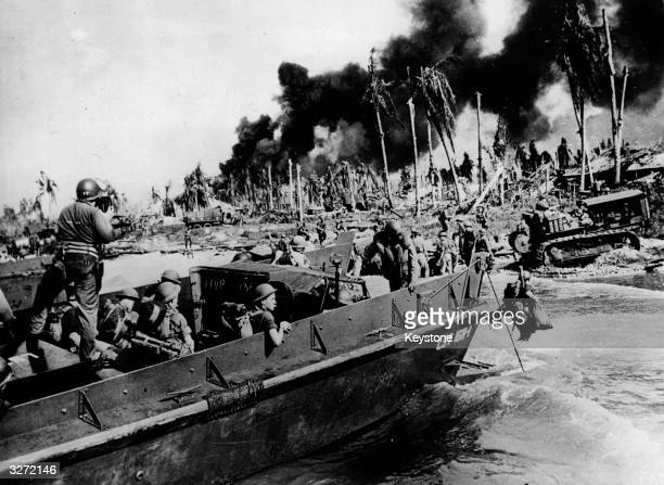 Australia troops launch an attack on the beach at Balikpapan on the south east coast of Borneo