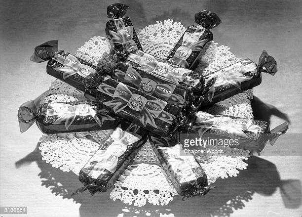 A plateful of Blue Riband biscuits on a paper doily