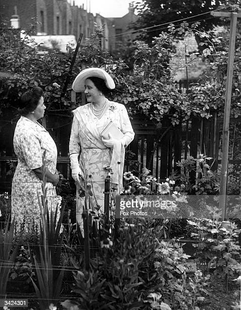 Queen Elizabeth Queen Consort to King George VI visiting Mrs A E Cook's garden in Bethnal Green East London during a tour of prize winning gardens in...