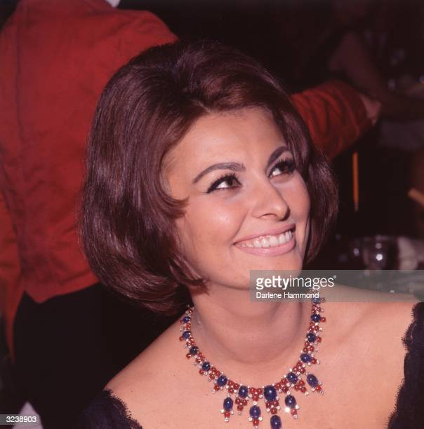 Headshot of Italian actor Sophia Loren wearing a jeweled necklace at a party honoring her Academy Award and her appearance in director Federico...