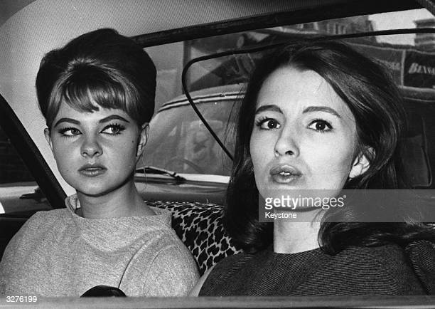 Mandy RiceDavies who rose to fame for her part in the 'Profumo Affair' sits in a car with Christine Keeler who is also a model and show girl after...