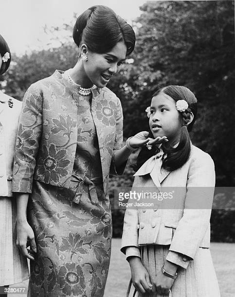 Queen Sirikit of Thailand and her nine year old daughter Princess Chulabhorn at her Sunninghill residence in Berkshire.
