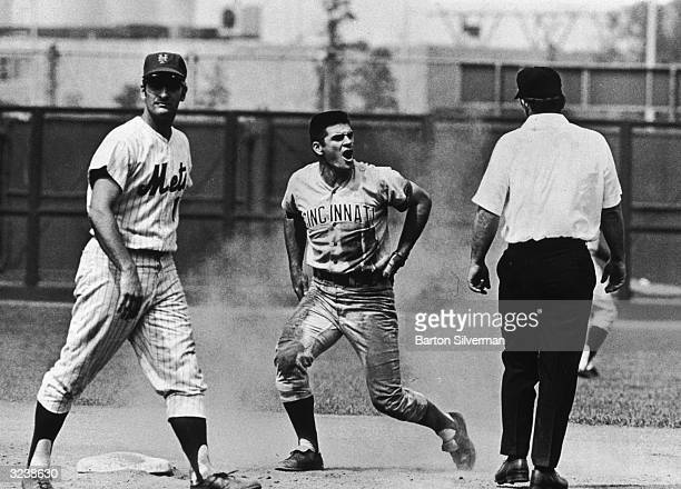 American baseball player Pete Rose of the Cincinnati Reds yells at umpire Bob Burkhart after he was called out at second base in a game against the...