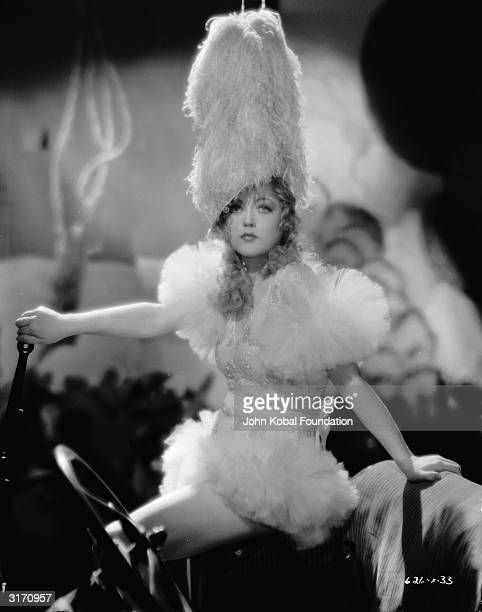 American actress Marion Davies wearing an extraordinary headdress for the film 'Blondie of the Follies' directed by Edmund Goulding