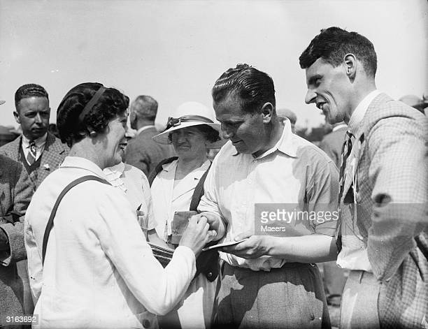 Golfer Jack Adams signs an autograph for an admiring fan at the British Open Golf Championships final at the Royal Liverpool Golf Course at Hoylake.