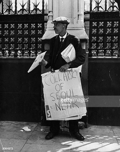 A newspaper seller in London's Westminster holds a billboard announcing 'Collapse of Seoul Near' two days after the start of the Korean War